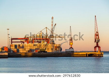 Lisbon's commercial port at sunset  in Lisbon, Portugal - stock photo