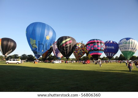 LISLE, IL - JULY 3: Hot Air Balloons prepare to takeoff in the morning sky at the Annual Hot Air Balloon Festival Eyes to the Skies and for celebration of Independence Day on July 3, 2010 in Lisle, IL