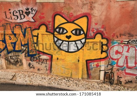 Lissabon, Portugal, November 5, 2013. Anonymous graffiti image shows merry cat ready to embrace you. Graffiti is located in old city.  - stock photo