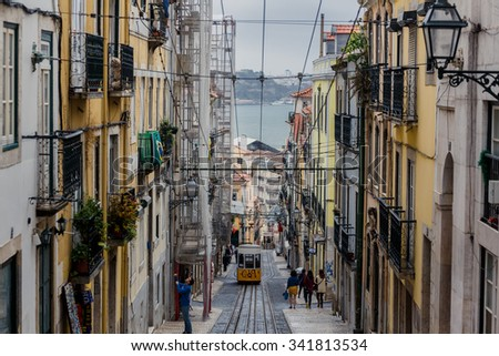 LISSABON, PORTUGAL - OCTOBER 17, 2015: Famous Bica funicular on street of Lissabon. It was constructed by Raoul Mesnier de Ponsard and opened in 1892 - stock photo