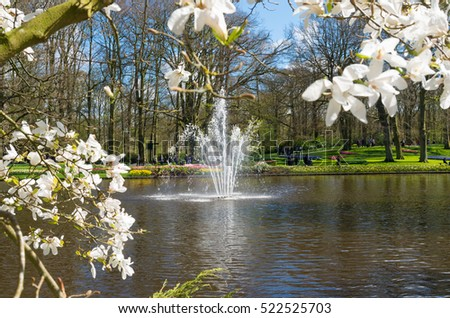 LISSE, NETHERLANDS - APRIL 17, 2016: Fountain in the famous Keukenhof tulip gardens in the netherlands