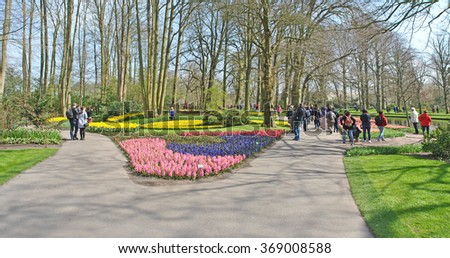 LISSE/SASSENHEIM, THE NETHERLANDS, CIRCA APRIL 2015 - Panoramic view of flower fields in the Keukenhof gardens. - stock photo