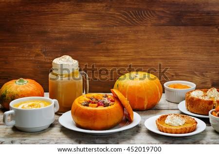 List of pumpkin dishes. Pumpkin Latte; Pumpkin stuffed with meat and vegetables; pumpkin tartlet; pumpkin soup; pumpkin puree. toning. selective focus - stock photo