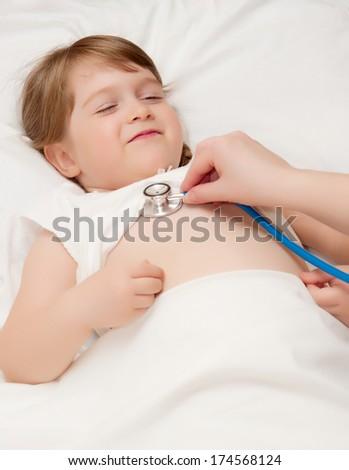 Listen by stethoscope little smiling girl - stock photo