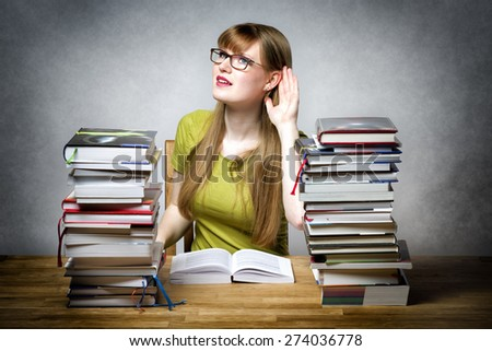 Listening female student with books - stock photo