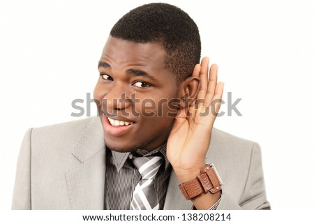 Listening man cupping ear - stock photo