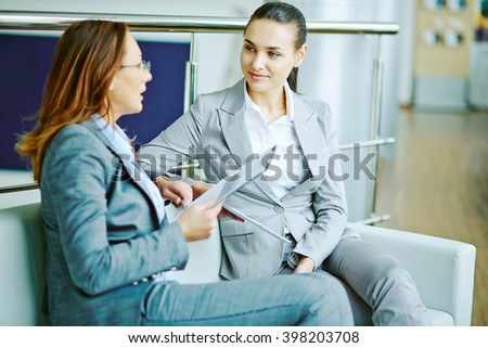 Listening to colleague - stock photo