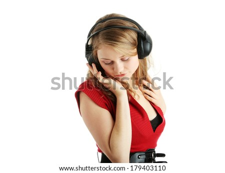 Listening to the Music, young caucasian beautiful blond woman with headphones, isolated on white background - stock photo