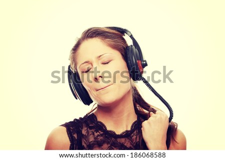 Listening to the Music, young caucasian beautiful woman with headphones - stock photo