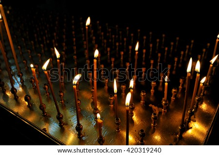 lit candle inside of an Orthodox Church - stock photo