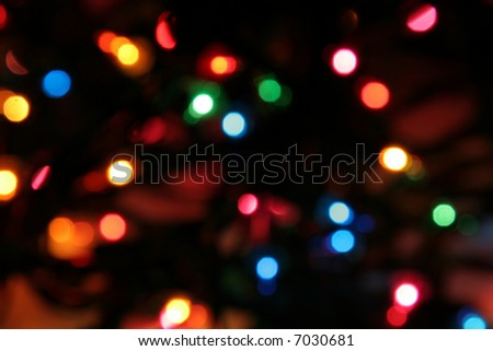 lit christmas lights strand deliberately blurred to give an interesting look - Christmas Light Strands