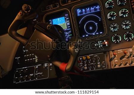 Lit iluminated pilot cabine dashboard cockpit - stock photo