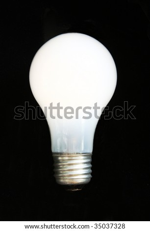 Lit Incandescent Light Bulb with steel base isolation on black