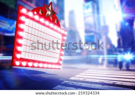 Lit up billboard against blurred new york street - stock photo