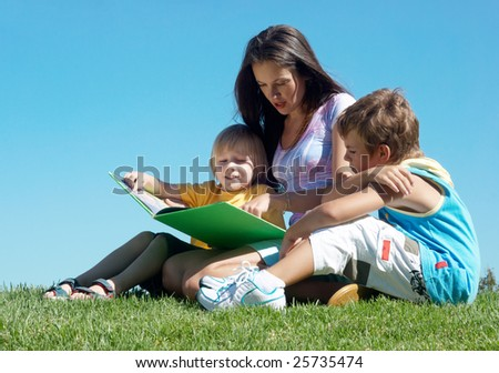 Literature lesson on fresh air - stock photo