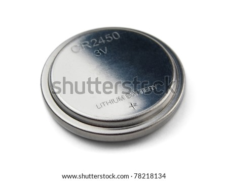 Lithium button cell battery isolated on white - stock photo