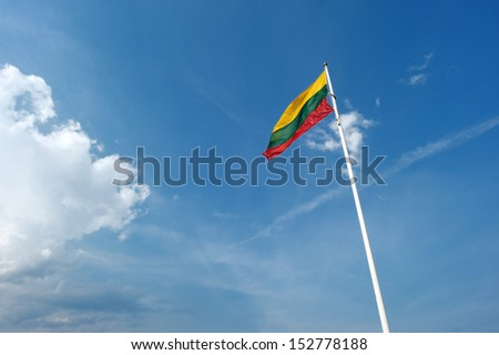 Lithuania flag on a blue sky background - stock photo