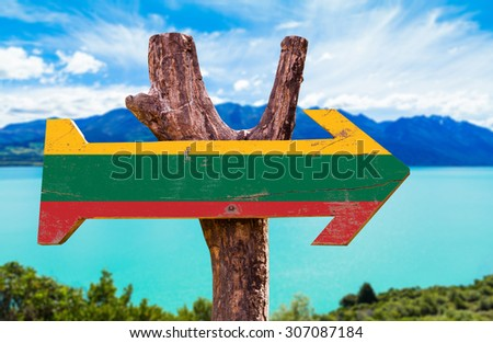Lithuania Flag wooden sign with lake background - stock photo