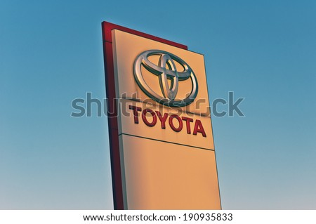 LITHUANIA - MAY 04:TOYOTA logo in the blue sky on May 04,2014 in Lithuania.Toyota Motor Corporation is a Japanese automaker headquartered in Toyota, Aichi, Japan.