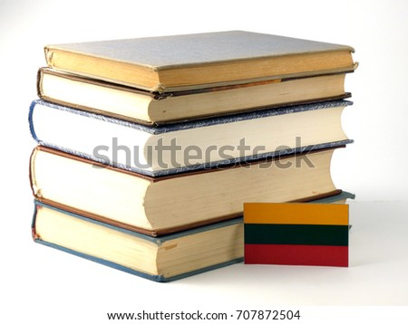 Lithuanian flag with pile of books isolated on white background