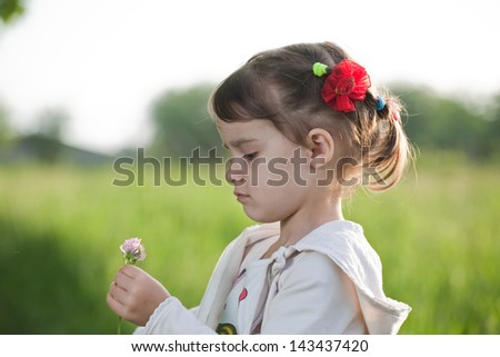 Litle girl on the meadow - stock photo