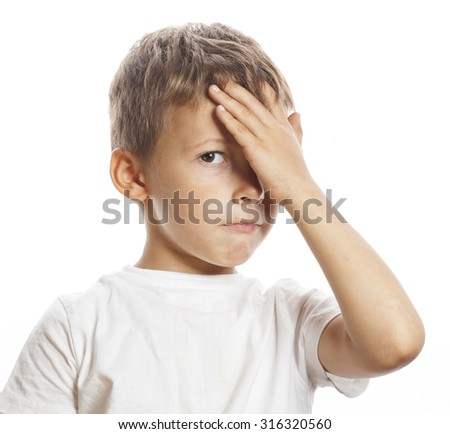 litlle cute blond boy tired sad isolated close up thinking - stock photo