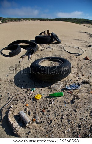Litter and waste pollution on our coastal beach. environmental problem - stock photo
