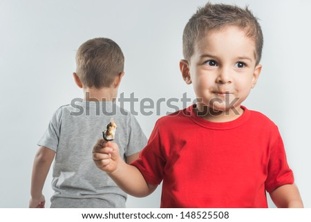 Littie boy in red finished his ice cream - stock photo