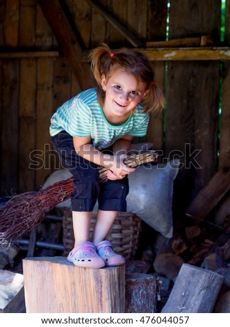 Little adorable girl  having fun on broomstick.