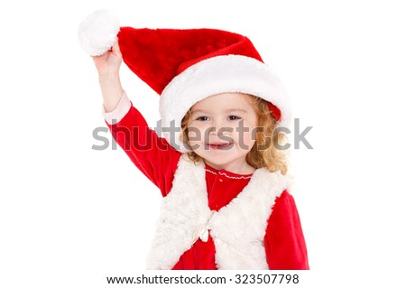 little adorable girl of 2 years on christmas isolated in white. studio shot. Lovely child in Santa hat, smiling. Christmas and new year. - stock photo