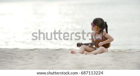 how to play hawaiian guitar