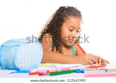little adorable girl working at her desk - stock photo