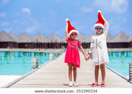 Little adorable girls during Christmas beach vacation - stock photo