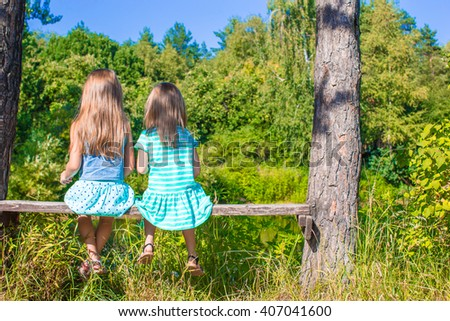 Little adorable girls outdoors at summer time - stock photo