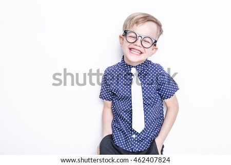 Little adorable kid in tie and glasses. School. Preschool. Fashion. Studio portrait isolated over white background