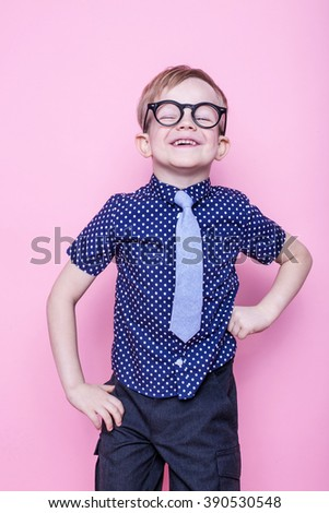 Little adorable kid in tie and glasses. School. Preschool. Fashion. Studio portrait over pink background - stock photo
