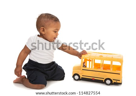 Little African American Baby Boy Pushing Toy School Bus on White Background - stock photo