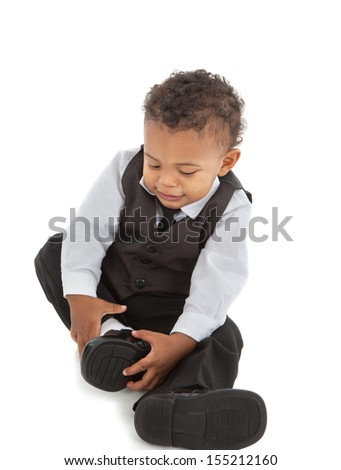 Little African American Baby Boy Put Shoes On - stock photo