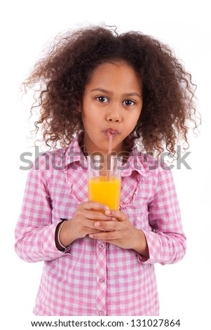 Little african asian girl drinking orange juice,isolated on white background - stock photo
