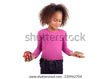 Little African Asian girl hesitating between fruits or  candy,isolated on white background