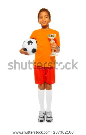 Little African boy holding soccer ball and prize - stock photo