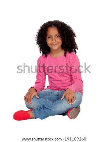 Little african girl sitting on the floor isolated on a white background