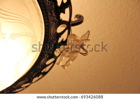 little angel on chandelier