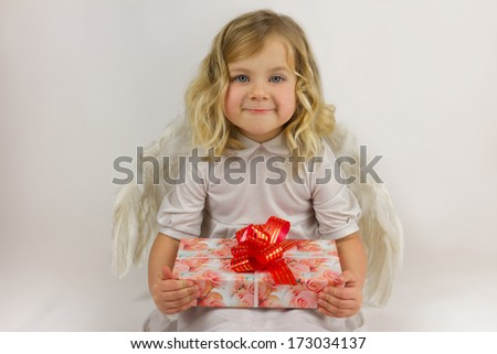 Little angel with gift