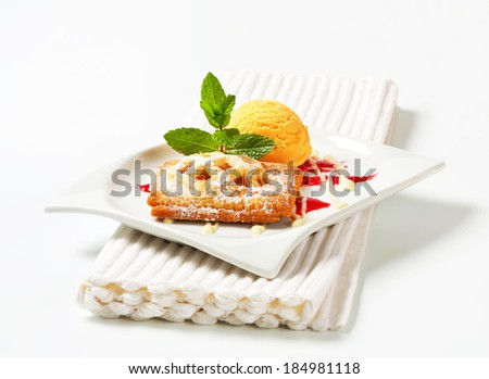 Little apricot pie with ice cream and drizzle sauce - stock photo