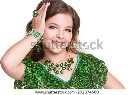 Little arabic belly-dancer. Beautiful arabian little child with curly hair. Portrait of baby artist  - stock photo
