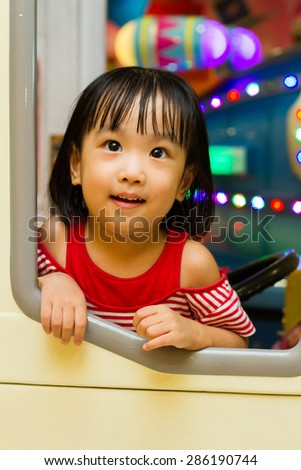 Little Asain Chinese Bus Driver at indoor playground - stock photo