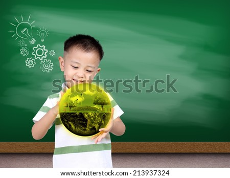 Little asia boy holding the earth with Green chalk board, (Knowledge concept),  Earth globe image provided by NASA - stock photo