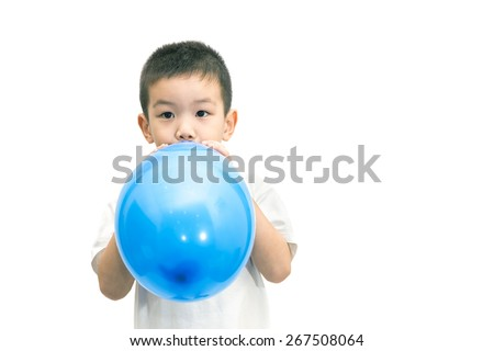 Little asian boy blowing a blue balloon isolated on white background - stock photo