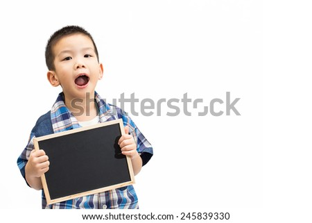 Little asian boy hands holding a blank blackboard with excited face isolated on white background - stock photo
